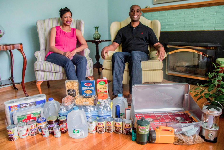 Man and woman sitting with prepping supplies.